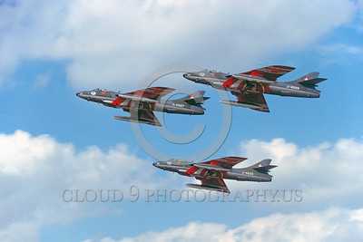 SAFPS-HUN 00002 A flying formation of three Swiss Air Force Hawker Hunter jet fighters PATROUILLE SUISSE aerobatic flight demonstraton team military airplane picture 10-1993 by Peter J Mancus
