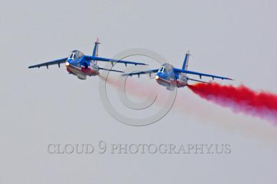 Patrouille de France 00050 A flying two-ship Dassault-Breguet Dornier Alpha Jet Patrouille de France military airplane picture by Peter J Mancus