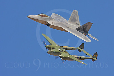 "This picture captures two of Lockheed's best fighter airplanes: The olive drab World War II era P-38 Lightning and the silver grey F-22 Raptor.   The P-38's first flight was on January 27, 1939. It was a very successful U.S. Army Air Force, long range, high altitude interceptor.   P-38 pilots, flying 550 miles from their base, intercepted and destroyed a Mitsubishi transport that carried Japanese Navy Admiral Yamamoto who planned the December 7, 1941 attack against Pearl Harbor. USAAF Capt. Richard I. Bong used P-38s to score 40 confirmed kills against Japanese airplanes, which made Bong the USAAF's top-scoring fighter pilot.   Thousands of P-38s were built between 1937 to 1945. USAAF pilots flew P-38s with great success against the Japanese in the Pacific and against the Germans in Europe. British Royal Air Force pilots also flew P-38s.  Lockheed Martin's F-22 Raptor is the world's only current ""Fifth Generation"" airplane. It is a true, world class, ""kick butt"", air superiorty fighter with stealthy features and an internal weapons load of lethal air-to-air medium range and short range missiles. The Raptor is in a class by itself. Nothing can stay in the air against a Raptor pilot intent on destroying it. Repeat: NOTHING.  The F-22's maiden flight was on September 7, 1997, 58 years after the first P-38 flew.  The U.S. Congress passed a law making it illegal to sell the F-22 to--or to license it for manufacture in--even the United States' best allies, such as Britian, Germany, Canada, Japan, or Israel, which has antagnoized key persons in Japan and Israel who have expressed a strong interest in buying Raptors. As a practical matter, however, the United States is probably the only nation, or one of few, wealthy enough to acquire and operate even one F-22 squadron.  It has been reported that F-22 Raptor pilots, over instrumented ranges, during its tactics development stage, during intense mock missions against U.S. and Allied pilots, achieved a kill ratio, at one time, of 75 to 0, in favor of the Raptor, and approximately 250 to 3-4, in favor of the Raptor, with the 3-4 being explained away as ""dumb luck"".  A retired U.S. fighter pilot friend told me that as the U.S. Air Force acquires more F-22s, it will let much younger, less experienced pilots with proven superior aptitude, fly the F-22, treating it as another cockpit that needs to be filled with first rate talent.  Even though the F-22 is excellent, a majority in the U.S. Congress opposes appropriating more money to build more than about only 180 F-22s. This is because Congress' senior leaders [misleaders?] opine that A) the Raptor's technology is 100% irrelevant for ""low tech"" wars in Iraq and Afghanistan, B) the former Soviet Union is no longer a threat, and C) they want to buy only military hardware that is ""relevant"" to ""low tech"" wars, such as UAVs [Unmanned Aerial Vehicles].  A large part of the U.S. Air Force's senior leadership wants to buy approximately 340 F-22s, but Congress seems to be determined to appropriate enough money to buy only 180-184. A substantial part of the U.S. Air Force's senior leadership wants to buy less than 180 F-22s to free up money earmarked for the F-22 so more of the less expensive, less capable, F-35 stealth like, fighter can be bought. Thus, even the U.S. Air Force's senior leadership lacks a 100% consensus regarding what mix of airplanes they should buy.  Even 340 is not many, especially for a nation that fancies itself to be the world's only remaining ""Super Power"". Despite technology's advances, the world is still a big place, and much of it is not friendly toward the United States.  The probable production run for the F-22 will likely be only about 20% of the production run for the fighter versions of McDonnell-Douglas' F-15 Eagle, which is the airplane the F-22 is earmarked to replace as the United State's ""back bone"" ""air superiority"" fighter.  New technological capabilities can compensate for small numbers, but achieving a prudent balance between ""few in number superior technology"" airplanes versus ""many technologically inferior"" airplanes is a challenging task that defies consensus building. At a minimum, an overreliance on too few of anything ""superior"" is dangerous. The German Air Force in World War II, the Luftwaffe, for example, toward the end of the war, had the world's first operational jet fighter, the Me-262. Germany's Me-262 was so superior to the United States' and its allies' best fighters and best bombers, that the discovery of the Me-262's existence alarmed many within the U.S. Army Air Force. However, the U.S. Army Air Force's vastly superior numbers of substantially inferior airplanes overwhelmed the Me-262s.  To the extent that one F-22 is, arguably, as lethal as one or more entire squadrons of F-15s [12-24 airplanes to a squadron], the ""ugly"" side of that logic is this: the loss of one F-22, by accident or in combat, is, arguably, the functional equivalent of the loss of 12-24 F-15s.  There is another angle, or important consideration, regarding this perrenial question: What is the proper mix between less expensive, less capable fighters and more expensive, more capable fighters? Ponder this: Although the F-22 is indeed awesome, and its lethality against any other airplane [assuming a good pilot] is, arguably beyond meritorious dispute, the F-22 has one significant limitation: Its weapons are limited to one internal gun, two short range missiles and four medium range missiles. Thus, assuming a F-22 pilot can assuredly destroy six enemy airplanes with its six missiles [one missile per plane], and can destroy five enemy planes with its gun's finite capacity ammunition [which is a generous stretch in favor of the F-22 which is probably unrealistic], what happens if a F-22 encounters twelve or more inferior but still lethal airplanes flown by competent, aggressive, pilots? Can a ""defanged"" F-22 survive in that environment? Thus, it is misleading to consider the F-22 in only a 1 versus 1 scenario. To be realistic, and prudent, one also needs to consider the vital issue of ""mix"": What is the most prudent ""mix"" of airplanes to buy? Why?  Are the most senior leaders of the U.S. Congress well qualified to address this issue, namely, what is the most prudent ""mix"" of airplanes for the U.S. Air Force to buy? Probably not.  The U.S. Air Force's ""F-22 community"" [highly skilled pilots and ground support technicians] and hardware assets, such as airplanes and weapons, are true national assets, worth many times their weight in gold. Anyone who disagrees with that opinion should ask themselves this question: Do they need to experience an aerial attack before they comprehend how vital a dominant air superiority fighter is, to deter war? To secure, and to keep, ""air superiority"" once war begins?  Regardless of how much money Congress might throw at the U.S. Air Force once a war starts, realistically, an unlimited amount of money does not translate into the quick standing up of a new F-22 squadron, let alone a well honed one. Lockheed Martin needs time to build the airplanes, and the U.S. Air Force needs time to acquire and train personnel to forge them into an effective fighting force--to put the ""force"" into U.S. Air Force. Congress' misleaders, however, manifests deception and delusion.   ""Deception"" is what one tells some one else, to mislead them, e.g., the F-22 is so superior the U.S. Air Force only needs 180 of them.   ""Delusion"" is what one tells oneself, to rationalize away why one does not do what they should, e.g., as they pursue their folly and their schemes to get themselves re-elected, instead of doing what is necessary to promote the nation's ""national interests"".   Realistically, the odds are high that 180 F-22s is nowhere near enough for what the U.S. Air Force should have to help maintain the peace, to help deter war, and to help win wars.  I am confident that Russia's Putin, North Korea's leadership, and Communist China's leadership are thrilled that the U.S. Congress has appropriated enough money to build less than 200 F-22 Raptors.  Lockheed Aircraft Company needed two years to build and fly the first P-38 after it got that contract, and the P-38's technology is primitive compared to the F-22's.   If Congress does not appropriate enough money to buy many more F-22s, if it turns out that the U.S. Air Force needs 300 to 900 or more F-22s, Lockheed Martin, with or without help from its main rivals--Boeing and Northrop, would not be able to build enough of them fast enough. F-22s cannot be produced like Model T Fords or sugar cookies. Furthermore, it is unlikely that this nation's enemies would allow American industry to gear up to pruduce what it needs, in time to have a positive effect on the outcome of a war. This is because the oceans and intercontinental distances are no longer the barriers they use to be, as in the 1940s, and it is foolish to under estimate the cunning, the skill, the vision, the will, and the tenacity of our nation's actual or potential enemies or both.  Even though the U.S. Air Force, and the U.S. Armed Forces, as a whole, have budgets in the hundreds of billions, everything is relative. I am inclined to entertain a strong suspicion that the stark truth is this: The current senior U.S. Congressional leadership functions in a way that flirts with gross incompetence, gross civic malpractice, horrific fiscal irresponsibility, criminal negligence, callous indifference, and treason. I include ""treason"" because many, if not most, members of Congress manifest treason. They usurp power without so much as a hiccup or a nano second's reflection. They routinely lie to us and mislead us. They are constantly campaigning instead of fixing problems. They do not really solve problems; instead, they make most problems worse. Their ""solutions"" are, at best, only a ""trade-off"", not a true ""solution"". And they routinely function above and against, ""We the People"" and our Supreme Law, the United States Constitution.  Returning to this airplane picture, I stress this: Even though this picture shows two ""fighters"" with maiden flights separated by 58 years, they share these structural features: 1) a forward bubble canopy, 2) two engines, 3) twin tails, 4) high wings, and 5) the F-22, even in the ""missile age"", has an internal canon, one that will spit out lead faster than all of the P-38's guns combined."