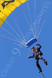 LEAPFROGS 00001 A US Navy LEAPFROG SEAL parachute team member descends to open a US Naval Aviation Centennial airshow, by Peter J Mancus