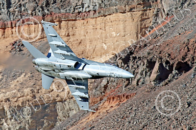 MLLF 00001 A Boeing F-18C Hornet, US Navy jet fighter, VX-9 VAMPIRES, on a low level training flight through a canyon, military airplane picture by Peter J Mancus