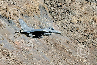 MLLF 00028 A Lockheed Martin F-16 Fighting Falcon USAF jet fighter 85551, ED code, flies low through a canyon on a training mission, military airplane picture by Peter J Mancus