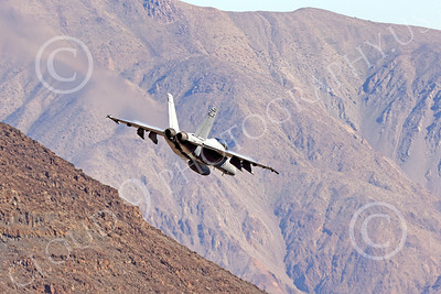 MLLF 00033 A Boeing F-18F Super Hornet USN VX-9 VAMPIRES jet fighter begins its dive into a canyon during a training mission, military airplane picture by Peter J Mancus