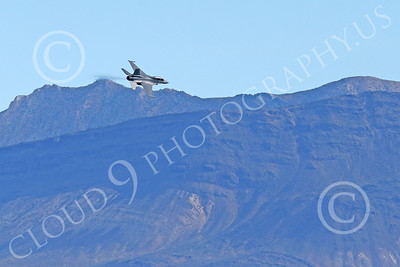 MLLF 00022 A Lockheed Martin F-16 Fighting Falcon USAF jet fighter, ED code, begins its dive for a low level high speed run during a training mission, military airplane picture by Peter J Mancus