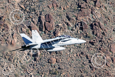 MLLF 00035 A Boeing F-18F Super Hornet US Navy jet fighter 165921 VFA-122 FLYING EAGLES flies low through a large canyon during a training mission, military airplane picture by Peter J Mancus