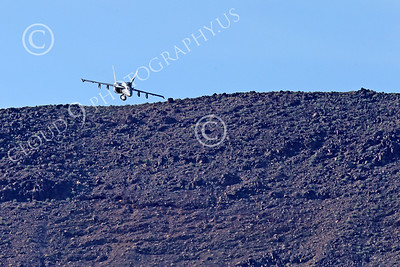 MLLF 00003 A Boeing F-18E Super Hornet jet fighter, US Navy, flies low over a ridge line on a training mission, military airplane picture by Peter J Mancus