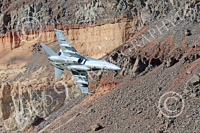 MLLF 00017 A Boeing F-18C Hornet, US Navy jet fighter, VX-9 VAMPIRES, on a low level training flight through a canyon, military airplane picture by Peter J Mancus