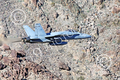 MLLF 00006 A Boeing F-18C Hornet, US Navy jet fighter, VX-9 VAMPIRES, XE code, on a low level training flight through a canyon, military airplane picture by Peter J Mancustif