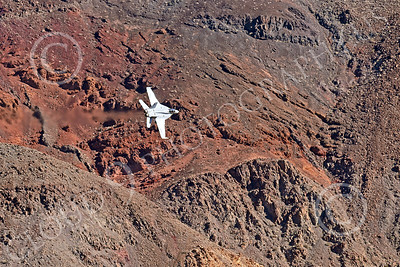 MLLF 00020 A Boeing F-18F Super Hornet USN VX-9 VAMPIRES jet fighter flies low through a canyon during a training mission, military airplane picture by Peter J Mancus
