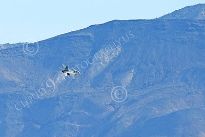 MLLF 00038 A Lockheed Martin F-16 Fighting Falcon USAF jet fighter, ED code, begins its dive for a low level high speed run during a training mission, military airplane picture by Peter J Mancus