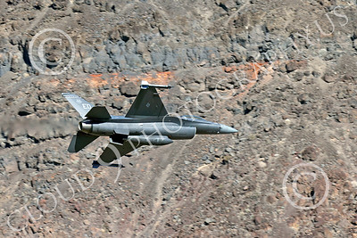MLLF 00012 A Lockheed Martin F-16 Fighting Falcon USAF jet fighter 85551, ED code, flies low over into a canyon on a training mission, military airplane picture by Peter J Mancus