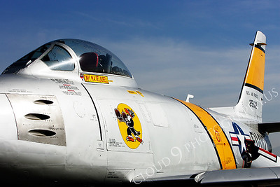NA 00003 Nose art on USAF F-86 Sabre -- Boxing Buzzard, by Peter J Mancus