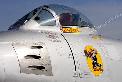 NA 00002 Nose art on USAF F-86 Sabre -- Boxing Buzzard, by Peter J Mancus