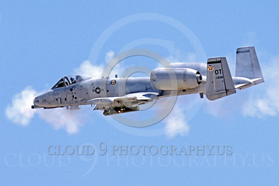 OR 00004 A USAF Fairchild A-10 Thunderbolt II flying tank killer fires its 30mm Gatling canon, by Peter J Mancus