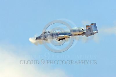OR 00016 A USAF Fairchild A-10 Thunderbolt II fires its 30mm Gatling gun, by Peter J Mancus