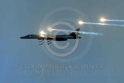 OR 00048 A USAF B-1B Lancer on a bomb run drops bombs and pops flares, by Peter J Mancus