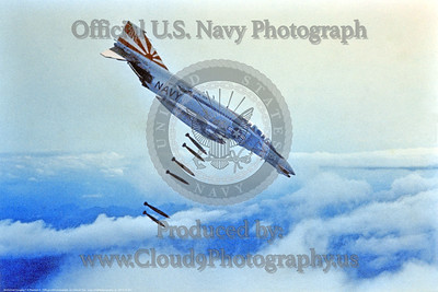 OR-F-4II 001 A McDonnell Douglas F-4 Phantom II USN jet fighter VF-111 SUNDOWNERS drops conventional bombs in a dive USN photograph via Tailhook Col  produced by Cloud 9 Photography     DONEwt