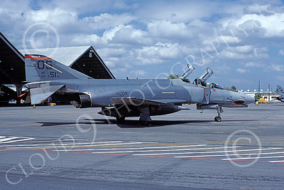 F-4USAF 00321 A static McDonnell Douglas F-4E Phantom II USAF 69551 51st TFW OS code SHARKMOUTH MiG KILLER 2-1987 military airplane picture by Tony Baker