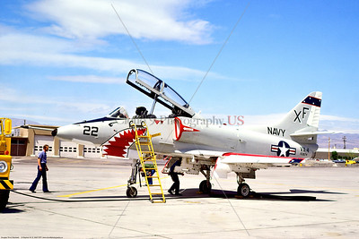 TA-4-USN-VX-4 002 A static Douglas TA-4J USN Skyhawk, 153674, VX-4 THE EVALUATORS, with large sharkmouth, 4-1975 NAS Nellis AFB, military airplane picture by Stephen W  D  Wolf      BBB_9910     Dt