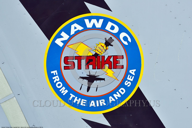 """SWCI 00026 This """"NAWDC STRIKE FROM THE AIR AND SEA"""" artwork on the tail of a USN Boeing F-18 Super Hornet at NAS Fallon 4-2016 sends a stark warning to the USA's actual and potential enemies, military airplane picture by Peter J  Mancus"""