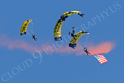 LEAPFROGS 00002 Four US Navy Seal LEAPFROG parachute team members open a US Naval Aviation Centennial airshow, by Peter J Mancus