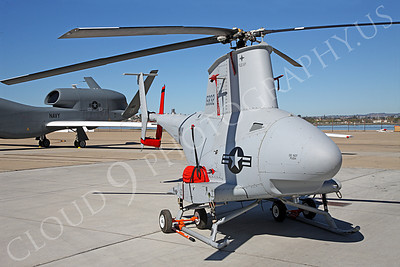 FireScoutUSN 00002 This unmanned Fire Scout helicopter and unmanned Global Hawk in the background point to naval aviation's future, by Peter J Mancus