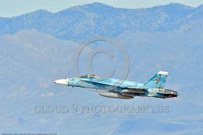TOPG-F-18 0006 A blue color scheme McDonnell Douglas F-18 Hornet USN jet figher 164066 TOP GUN climbs out after take off at NAS Fallon 3-2017 military airplane picture by Peter J  Mancus