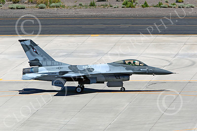 TOPG 00036 Lockheed Martin F-16 US Navy 920408 TOP GUN Navy Fighter Weapons School taxies back to its assigned parking spot at NAS Fallon, Nevada, by Peter J Mancus
