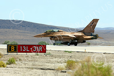 TOPG 00050 Lockheed Martin F-16 US Navy 920460 TOP GUN Navy Fighter Weapons School begins its take off roll at NAS Fallon, Nevada, by Peter J Mancus