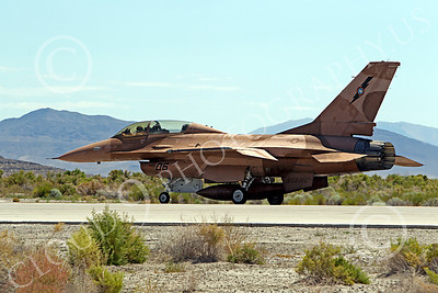 TOPG 00013 Lockheed Martin F-16 US Navy 820460 TOP GUN Navy Fighter Weapons School taxies to take off at NAS Fallon, Nevada, by Peter J Mancus