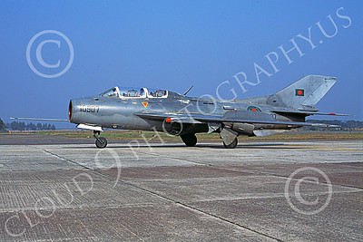 MiG-19 00001 A taxing gray Mikoyan-Guryevich MiG-19 Farmer Bangladesh Air Force military airplane picture by Rogier Westerhuis