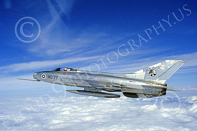 Mikoyan-Guryevich MiG-21 Fishbed 00006 An in-flight bare metal Finnish Air Force MiG-21F jet fighter, 8-1985, by Stephan Mathis