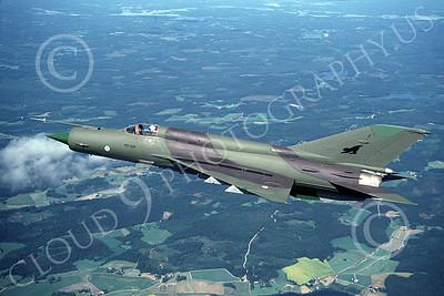 Mikoyan-Guryevich MiG-21 00006 An in-flight green Finnish Air Force Mikoyan-Guryevich MiG-21 jet fighter CRASHED 11-1992, by Karl Siemen