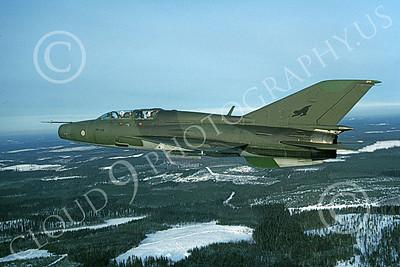 Mikoyan-Guryevich MiG-21U Mongol 00004 An in-flight green Finnish Air Force Mikoyan-Guryevich MiG-21U Mongol jet fighter trainer, 2-1997, by Karl Siemen