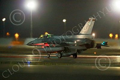 F-16Forg 00009 A taxing Singapore Air Force Lockheed F-16 Viper jet fighter awaits take-off clearance for a Red Flag mission Nellis AFB 7-2014 military airplane picture by Peter J Mancus