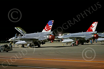 F-16Forg 00005 Two static colorful two seat Singapore Air Force Lockheed F-16 Viper jet fighters at night at Nellis AFB 7-2014 military airplane picture by Peter J Mancus