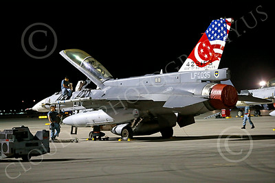 F-16Forg 00003 A static two seat Singapore Air Force Lockheed F-16 Viper jet fighter 96035 with a colorful tail at night at Nellis AFB 7-2014 military airplane picture by Peter J Mancus