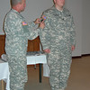 Me receiving my 1PERSCOM shoulder sleeve insignia patch (combat patch) from COL Smith.