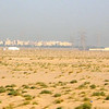 Welcome to Kuwait!!  These are white tents that travelers set up and live in.  They are in the middle of the desert and travelers will make their own village.