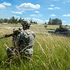 A U.S. Army Soldier from the 1st Brigade Combat Team, 1st Calvary Division watches a M1A2 Abrams Tank move into a offensive position during the Combined Arms Live Fire Exercise portion of Combined Resolve II at Grafenwoehr Training Area, Germany, June 27, 2014. The 1st Brigade Combat Team, 1st Cavalry Division is a multi-roled unit currently the 1/1 CD serves as the U.S. contingent of the NATO Response Force (NRF) and the U.S. Army's brigade combat team Regionally Aligned Force for Europe. (Photo by U.S. Air Force Staff Sgt. Andrew Davis)