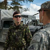 A U.S. Army instructor from the Joint Multinational Training Center speaks with a Romanian Army Soldiers prior to driving out to a exercise training area during the Combined Arms Live Fire Exercise portion of Combined Resolve II at Grafenwoehr Training Area, Germany, June 26, 2014. The CALFEX was the culmination exercise of Combined Resolve II that tested Romainia, U.S. and Georgian land forces interoperability in one of the worlds most sophisticated training areas. (Photo by U.S. Air Force Staff Sgt. Andrew Davis)