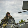 A Romanian Army Soldier recives enemy coordinates and firing orders atop his MLI-84M Infantry Fighting Vehicle during the Combined Arms Live Fire Exercise portion of Combined Resolve II at Grafenwoehr Training Area, Germany, June 26, 2014. (Photo by U.S. Air Force Staff Sgt. Andrew Davis)