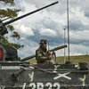 A Romanian Army Soldier does a final operations check on his radio atop his MLI-84M Infantry Fighting Vehicle during the Combined Arms Live Fire Exercise portion of Combined Resolve II at Grafenwoehr Training Area, Germany, June 26, 2014. (Photo by U.S. Air Force Staff Sgt. Andrew Davis)