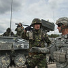 A U.S. Army instructor from the Joint Multinational Training Center speaks with a Romanian Army Soldiers about dismounted tatics during the Combined Arms Live Fire Exercise portion of Combined Resolve II at Grafenwoehr Training Area, Germany, June 26, 2014. The CALFEX was the culmination exercise of Combined Resolve II that tested Romainia, U.S. and Georgian land forces interoperability in one of the worlds most sophisticated training areas. (Photo by U.S. Air Force Staff Sgt. Andrew Davis)