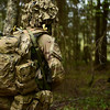 A British soldier acting as the oppositonal force surveys the woods ahead for any members of the Estonian Defence Force during Steadfast Javelin 1 in Southern Estonia, May 18, 2014. Members of the Alliance tested the skills and interoperability of the Estonian Defence Force to repel an attack. (Photo by U.S. Air Force Staff Sgt. Andrew Davis)