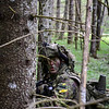 A soldier from the Estonian Scouts Battalion, acting as the opposition force, awaits the order to move forward on a position of Estonian Defence Forces during Steadfast Javelin in Southern Estonia, May 18, 2014. (Photo by U.S. Air Force Staff Sgt. Andrew Davis)