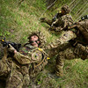 A British soldier from the Duke of Lancasters Regiment is dragged to cover after an unsuccessful attempt taking out a position held by the Estonian Defence Force during Steadfast Javelin 1 in Southern Estonia, May 18, 2014. (Photo by U.S. Air Force Staff Sgt. Andrew Davis)