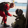 A diver from the Icelandic Coast Guard greets the Finnish Army NH-90 helicopter load-master after they both particpated in a Search and Rescue training on sea, involving both of Icelandic Coast Guard and Finnish Army Search and Rescue team, giving them the opportunity to test and practise their skills and interoperability during the Iceland Air Meet 2014 in Iceland on Feb. 13, 2014.<br /> The Iceland Air Meet 2014 (IAM2014) brings together participants from NATO member nations Norway, Iceland and the Netherlands, and from partner countries Finland and Sweden, to conduct a wide range of air defence-related flying activities.<br /> It is the first time that Finland and Sweden have deployed to Iceland. It  improves deployability and interoperability, provides additional training opportunities and further strengthen Nordic defence cooperation (NORDEFCO), between both NATO members and non-members.<br /> (NATO photo by Edouard Bocquet)