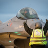 A Norwegian Crew Chief gives thumbs up to the pilot of a Royal Norwegian Air Force (Luftforsvaret) Lockheed Martin F-16AM/BM Fighting Falcon from 331 skvadron, signaling that the jet is ready to taxi down the runway for take-off, during the Iceland Air Meet 2014, Keflavik International Airport, February 12th, 2014.<br /> The Iceland Air Meet 2014 (IAM2014) brings together participants from NATO member nations Norway, Iceland and the Netherlands, and from partner countries Finland and Sweden, to conduct a wide range of air defence-related flying activities.<br /> It is the first time that Finland and Sweden have deployed to Iceland. It  improves deployability and interoperability, provides additional training opportunities and further strengthen Nordic defence cooperation (NORDEFCO), between both NATO members and non-members.<br /> (NATO photo by Edouard Bocquet)