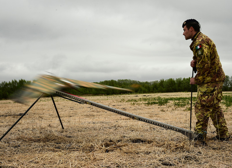 An Italian Air Force launches a Strix Unmanned Aerial Vehicle in a field in Brekstad, Norway during Unified Vision 14 Trial, May 23, 2014. The Italian UAV is a small electric powered aircraft that is controlled remotely from a Flight Control System that allows transmittal of real time video surveillance feed. (Photo by U.S. Air Force Staff Sgt. Andrew Davis)